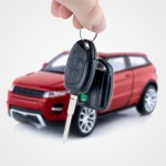 Hand holding keys to new car. Buy or selling business composition